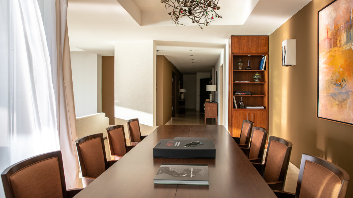 Jumeirah-port-Soller-Observatory-Signature-Suite-Living-Room-Telescoop-Couch-Desk-Windows-Dining-Area-Table